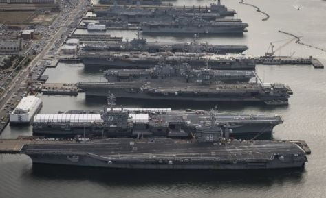 us_aircraft_carriers_stuck_in_port_by_obama